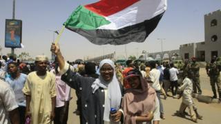 Demonstrators in Khartoum near the military headquarters, 13 April 2019