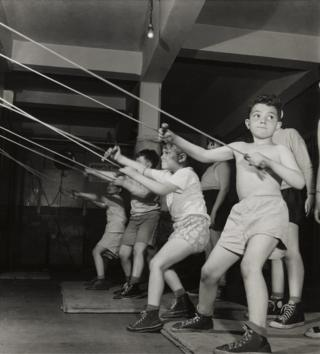 Boys exercising in the gymnasium of the Jewish Community House of Bensonhurst, Brooklyn, 1949.