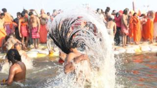 Hindu holy men taking a dip at the Sangam