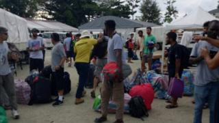 A photo a refugee says shows men leaving the Manus Island detention centre