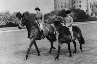 Queen Elizabeth II and her son, Prince Charles, out riding at Windsor Castle