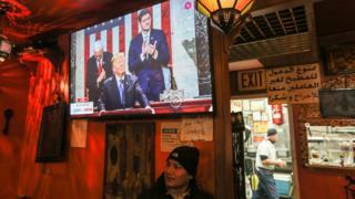 Man watches Trump speech in a Brooklyn bar
