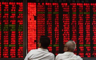 Investors monitor stock price movements at a securities company in Beijing on 15 June 2016
