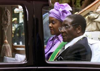 President Robert Mugabe and his wife Grace leave parliament in their ceremonial car after its official opening, Harare - 22 July 2003