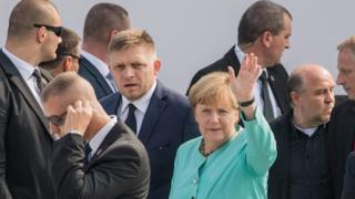 German Chancellor Angela Merkel next to Slovak Prime Minister Robert Fico (centre) during EU meeting in Bratislava on 16 September