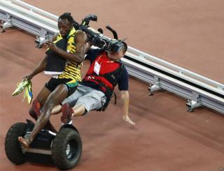 "A TV cameraman drives into Usain Bolt of Jamaica after the men""s 200m final during the Beijing 2015 IAAF World Championships at the National Stadium, also known as Bird""s Nest, in Beijing, China, 27 August 2015."
