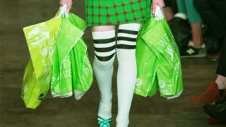 Green shopping bags and a green skirt