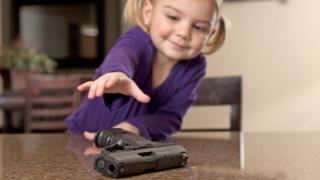Little girl with gun