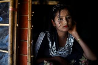 Rohingya refugee Juhara Begum, aged 13, poses for a photograph as she wears thanaka paste at Jamtoli camp in Cox's Bazaar, Bangladesh