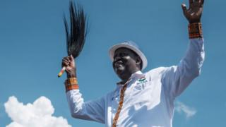 Kenya's opposition National Super Alliance (NASA) coalition leader Raila Odinga reacts to supporters during a political rally at Jacaranda grounds in Nairobi on September 17, 2017