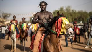 A horseman prepares to parade for the opening ceremony of the FESPACO The Panafrican Film and Television Festival of Ouagadougou, on February 23, 2019