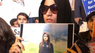 Laila Mangi with a poster of her missing sister Dua, Karachi 3 December 2019
