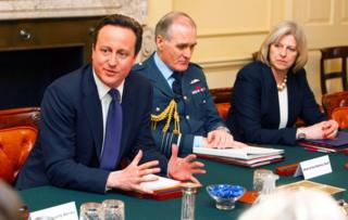 David Cameron, Sir Jock Stirrup and Theresa May in the Cabinet Room