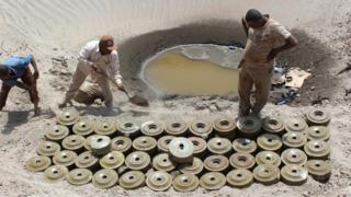 Yemeni demining experts prepare to destroy explosives and mines laid by Huthi rebels in the southern city of Aden. 5 April 2016
