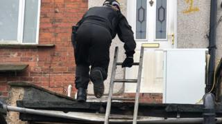 Officers carrying out searches