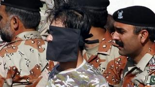 Pakistani Rangers hold a security guard accused of shooting an Afghan diplomat in Karachi, 6 February 2017