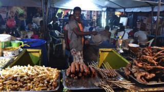 People cooking food in Ouagadougou, Burkina Faso - Monday 27 February 2017