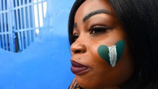 One Nigeria fan wey sidon for front of Stephen Keshi Stadium, Asaba