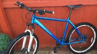 Blue white and black bike