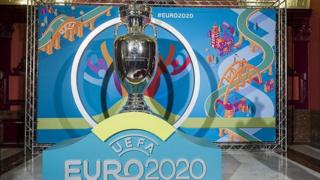 The European Championship trophy and Euro 2020 logo