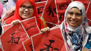 Malay teachers in Kuala Lumpur pose at a Chinese calligraphy event in conjunction with the upcoming Year of the Pig