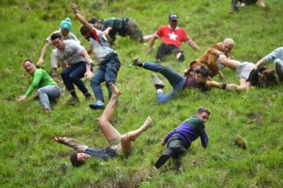in_pictures Participants take part in the annual cheese rolling competition