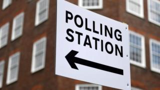 Sign directing people to a polling hire in London