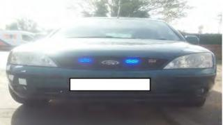 Ford Mondeo with blue lights fixed to front grille