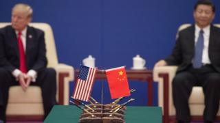 US President Donald Trump (L) and China's President Xi Jinping attend a business leaders event inside the Great Hall of the People in Beijing on November 9, 2017.