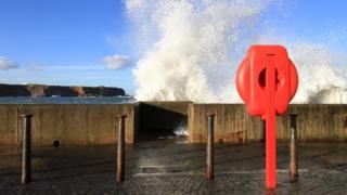 Waves crashing over Eyemouth sea wall