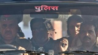 Rajesh Talwar (second from left) and his wife Nupur Talwar (second from right) arrive at a prison in India in 25 November 2013