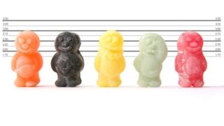 Police line up with sweets