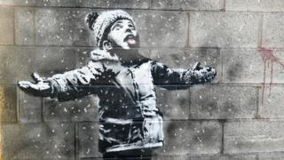 Banksy's 'Season's greetings' graffiti image in Port Talbot