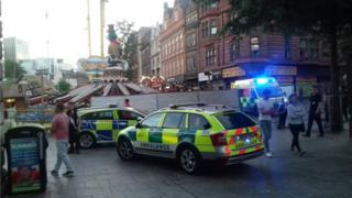 Emergency services at the scene after a woman was injured on a fairground ride