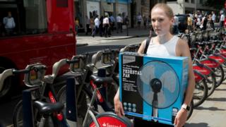 lady carrying fan