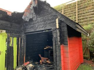 Burnt down beach hut