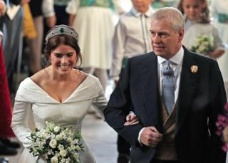 "Princess Eugenie walks down the aisle with her father, the Duke of York, for her wedding to Jack Brooksbank at St George""s Chapel in Windsor Castle"