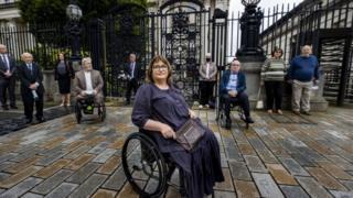 Jennifer McNern (centre) outside Belfast High Court On Monday