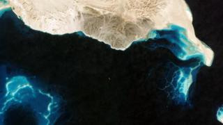 A satellite snaps a tanker that has turned off its AIS tracking system