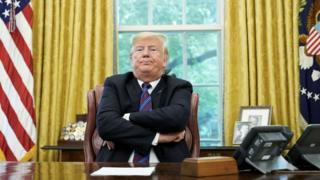 "In this file photo taken on August 27, 2018 US President Donald Trump speaks to reporters after a phone conversation with Mexico""s President Enrique Pena Nieto on trade in the Oval Office of the White House in Washington, DC."