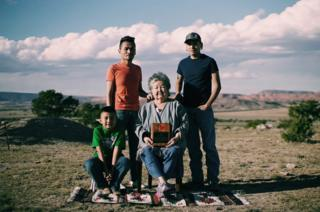 Sister Begay, 68 (centre) with her son Jonathan Begay, 33 (back left), her grandsons Marcus Begay, 27 (back right), and Calibe, 8 (front left)
