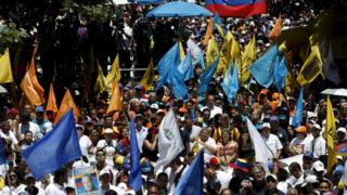 Opposition supporters take part in a rally against Venezuela's President Nicolas Maduro's government in Caracas, March 12, 2016.