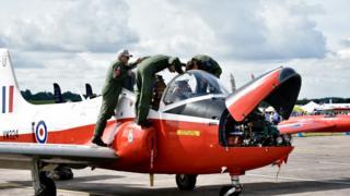 Crew examining an aircraft