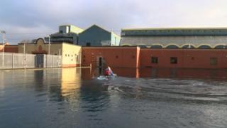 Man kayaking in an outdoor pool