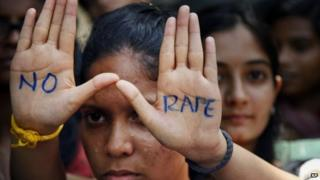 "An Indian student displays ""NO RAPE"" message painted on her hands during a demonstration to demand death sentence for four men convicted of rape and murder of a student on a moving bus in New Delhi"