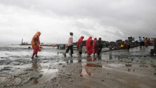 Hindu pilgrims hump relieve from the dock after a ferry carrier to Sagar Island become once suspended ensuing from Cyclone Bulbul