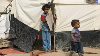 Children in the Ghazaliyah refugee camp near Baghdad