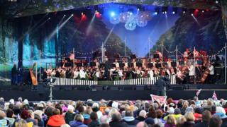 An orchestra performing at BBC Proms in the Park
