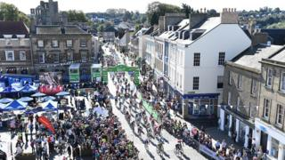 Cyclists starting the second stage in Kelso