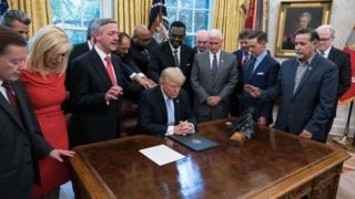 Mike Pence President Trump prays with faith leaders in the Oval Office